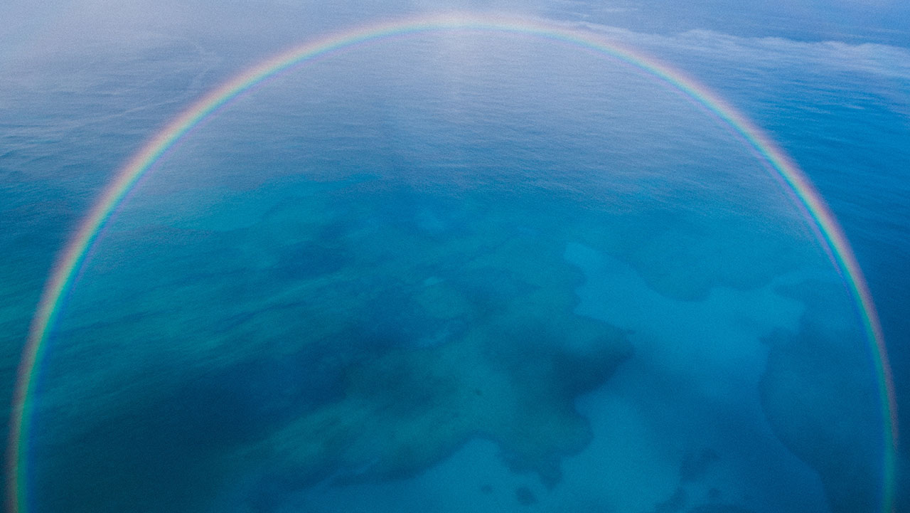 A rainbow over the ocean